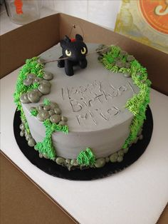 This would be easy to do with any toy theme. How to train your dragon personalized cake. The dragon is a toy I bought at the store. I  broke a twig off the tree outside and shoved it through. My niece loved it.