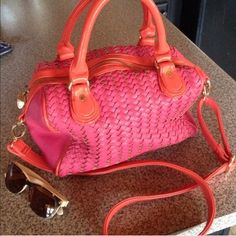 Deux Lux Woven Purse This is pink and orange slouchy bag with a purple silk interior. I used it briefly but it's in wonderful shape. No marks or blemishes besides one pen mark on interior pocket. See all pics. This is a great summer bag! Has shoulder strap too. Visit my closet for many under $10 deals! Deux Lux Bags Shoulder Bags