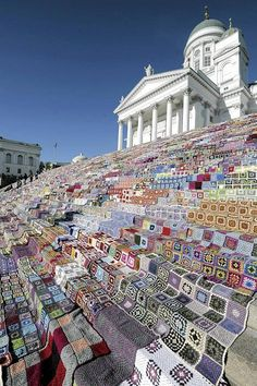 The story goes that 1000 blankets were expected at this yarnbombing event in Helsinki, Finland, but ended up with 7800 and used only about half the pile. After the yarnbombing event all the blankets were donated to the safe house movement. Yarn Bombing, The Places Youll Go, Places To See, Guerilla Knitting, Finland Travel, Urbane Kunst, Lutheran, Place Of Worship, Wonders Of The World