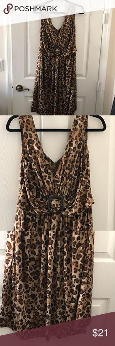 Ladies Leopard Dress Sz Lg Ladies Leopard V Neck Dress with decorative waist. Has a good stretch to it. Sz Lg NWOT No Name Dresses