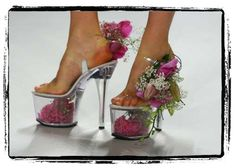 The ultra-high heels have have a clear hollow space in the platform bases stuffed full of blossoms and petals.