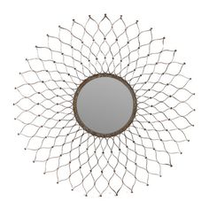 Weathered wall mirror with an Indian-inspired metal frame. Product: MirrorConstruction Material: Metal and mirrored gl...