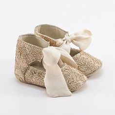 Leather baby shoes  covered with golden lace
