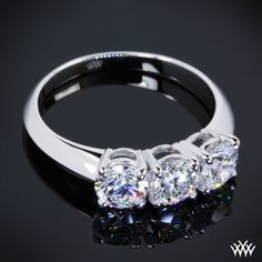 3 Stone Diamond Engagement Ring is set in 18k White Gold and features 3 0.30ct A CUT ABOVE® Hearts and Arrows Diamonds.