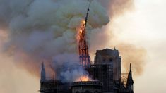 TOPSHOT - The steeple and spire of the landmark Notre-Dame Cathedral collapses as the cathedral is engulfed in flames in central Paris on April - A huge fire swept through the roof of the. Get premium, high resolution news photos at Getty Images Saint Chapelle, Fire Video, Paris Match, Saint Louis, Drame, French Revolution, Victor Hugo, Gothic Architecture, Architecture Design