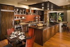Brilliant remodelling kitchen design with red tile backsplash and dark wooden kitchen cabinet also silver kitchen oven plus wooden flooring idea