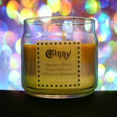 Ginny Scented 4oz Candle- Quidditch Pitch, Pygmy Puff, and A Flowery Somthing -