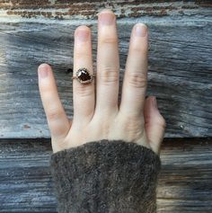 Custom Shaesby ring with a raw and unique shaped diamond with a pave setting, handcrafted in Austin, TX.
