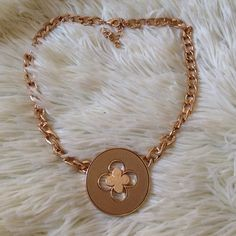 """Gold flower necklace Gold tone flower necklace. 22"""" long. Jewelry Necklaces"""