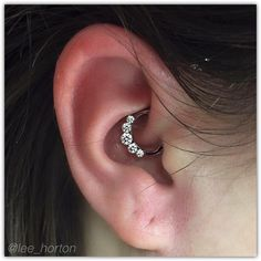 Quality jewelry from industrial strength in this daith piercing @legacytattoolondon London Ontario