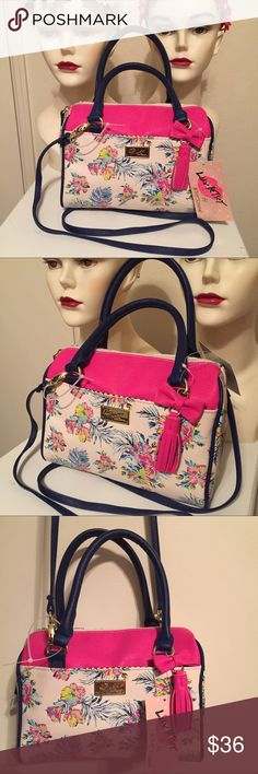 "NEW BETSEY JOHNSON Floral Mini Barrel Satchel Bag New BETSEY JOHNSON Handbag Authentic Betsey Johnson *LUV Betsey*  With detachable pink bow/tassel dangle. Faux leather-Cream/Blue/ Pink, Multicolor Floral, Blue handle & strap Exterior, Gold tone hardware, 1 Slip pocket, Top zip closure, Style: LBHARLET  Interior is lined in black and white striped fabric. No inside pockets. Measures 9.25""L x 4.5""W x 7""D Strap Drop 24"" MSRP - $58.00 Betsey Johnson Bags Satchels"