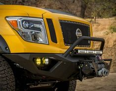 """This beastly four-wheel-drive camper is designed to weather the apocalypse in style. Affectionately dubbed the Rule Breaker,"""" this trail-ready Nissan was developed by Hellwig Suspension Products in association with Lance Camper. Slide In Truck Campers, Camper Parts, Small Campers, Nissan Titan Truck, 2016 Nissan Titan Xd, Lance Campers, 4x4, Motor Diesel, White Truck"""