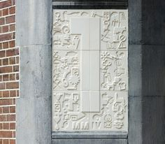 Tile panels in the frame of the door have been specifically designed for the service center. They refer to the current function of the building and enter into a relationship with the tableau of 1903 above the door.  - Sasja Scherjon (Google auto translation, Dutch to English)