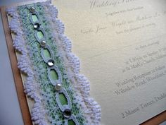 Aqua and Peach wedding invitations with lace detail