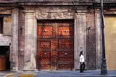 Walking along the old Spanish door in Centro Historico Mexico City.