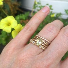 Golden Beryl is a pale yellow variety of Beryl. Beryl is best known for its famous gem varieties Emerald and Aquamarine. Here it is in rose gold and stacked with delicate bands.