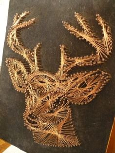 vintage 3D copper nail and wire deer head wall art on black velvet, woodland home decor. $30.00, via Etsy.