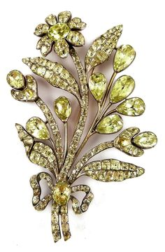 18th century chrysolite floral spray brooch, Portuguese, c.1760, designed as a floral and foliate spray tied with a ribbon, set with foil backed cushion-, pear-shaped, oval and mixed-cut chrysoberyl, later brooch fitting.