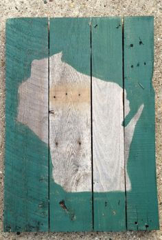Wisconsin - Wood Pallet Sign 18x24. This rustic wall art is hand crafted and hand painted on reclaimed wood from an old recycled wooden palette. You can use this sign indoor or outdoor, the sign is top coated with poly-clear for years of protection and is also ready to hang