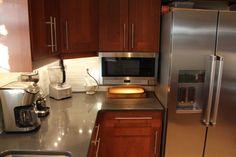 Finished Kitchen! Ikea Adel Medium Brown, Caesarstone Raven quartz, KitchenAid counter depth fridge