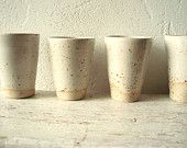 white ceramic cup via etsy