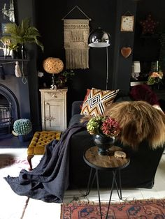 living room | home decor | house decoration | dark eclectic | moody | black | pops of color | fireplace