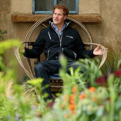 Prince Harry takes in the 'Hope in Vulnerability' garden designed by Matt Keightley for his charity, Sentebale, using the royal's Mamohato Children's Centre in Lesotho (which helps children with HIV) as inspiration. The prince perches in a Basotho chair.