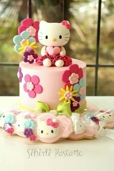 Hello Kitty Cake and Cookies - Cake by Sihirli Pastane: and like OMG! get some yourself some pawtastic adorable cat apparel! Gateau Hello Kitty, Bolo Da Hello Kitty, Hello Kitty Fondant, Hello Kitty Birthday Cake, Birthday Cake Girls, Hello Kitty Cookies, Happy Birthday, Fondant Cakes, Cupcake Cakes