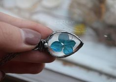 A personal favorite from my Etsy shop https://www.etsy.com/listing/492226537/blue-flower-drop-pendant-tiffany