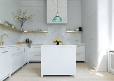 White Arrow has overhauled the early Glogauer Apartment in Berlin, adding storage space while preserving original features. Pierre Frey, Berlin Apartment, Apartment Interior, Kitchen Cabinetry, Kitchen Tiles, Room Kitchen, Kitchen Design, Banquette, White Tiles