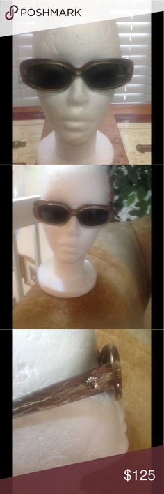 Versace Sunglasses Versace Medusa sunglasses with logo on arms. Beautiful condition, unusual hard to find style, retail $395 Accessories Glasses