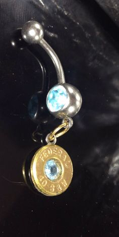 Bullet casing belly button ring by pertypertybangbangs on Etsy, $12.00