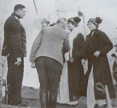 Grand Duchesses Olga and Tatiana greeted by officers.