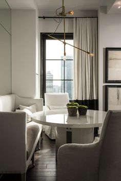 This elegant contemporary condo from Michael Dawkins features modern-day furnishings, large windows with an amazing view of the New York City skyline, and a lovely rooftop deck.