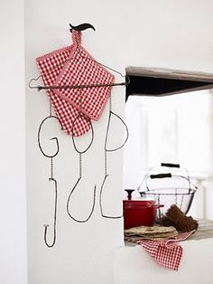 God Jul - try making Be Prepared motto out of wire and suspending like this. for Craftsman