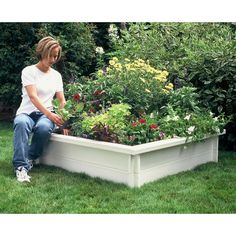 Recycled Plastic Raised Garden Bed by eartheasy! A great way to add dimension to any garden.