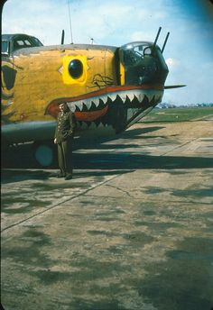 Menacing but amusing nose art on a B-24 Liberator seen on a period color slide