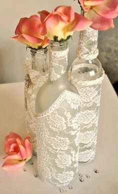 Wine bottles wrapped in lace with single rose Photo Source: sortrachen #centerpiece #winebottles #lace: