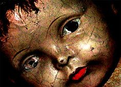 cracked porcelain doll face. she just needs a hug.