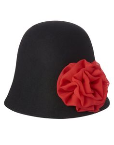 Chic wool hat looks extra dressy with a flower and gem.