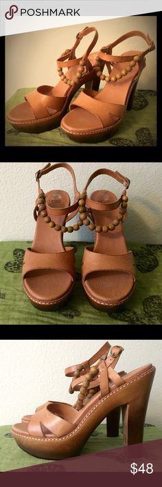 Lovely boho UGG Australia platform sandals :) I'm selling these lovely sandals, size 9 by UGG Australia. They have never been worn, except to try on indoors. No wear on the bottom of the shoe. They have a high heel, I would guess about 4 inches but I can measure it if needed. These neutral heels would be beautiful with a dress or classic blue skinny jeans :) UGG Shoes Platforms