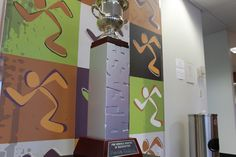 The PLEASE Award is displayed at the South Ames location at 414 S. 17th St., in Ames. The award is given out quarterly to the franchise that demonstrates exemplary customer service.  Photo by Grayson Schmidt/Ames Tribune  http://amestrib.com/news/ames-anytime-fitness-wins-national-award