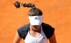 Laura Robson of Britain pauses during her womens singles match against Venus Williams of the U.S. at the Rome Masters tennis tournament May 13, 2013. Robson won the match 6-3 6-2. REUTERS/Alessandro Bianchi