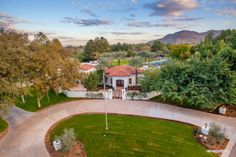 9201 N Martingale Road Paradise Valley, AZ 7 bed / bath / sq ft / tennis & volleyball court / guest house / all on over acres. Paradise Valley, Acre, Golf Courses, Farmhouse, Real Estate, Mansions, House Styles, Volleyball, Farms