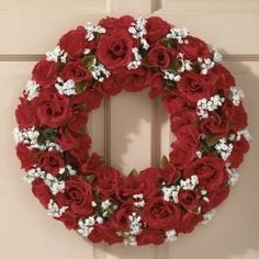 17 inch diameter Red Rose Wreath w Berry by KIGI. $19.99. A formal arrangement sets our breathtaking everlasting wreath apart from ordinary designs. Dozens of lifelike red roses and buds suggest nature's own with beautiful ruffled petals and serrate foliage. Artful snow-white baby's breath adds a dramatic contrast to the fiery blooms. This exceptionally well-made design features a covered foam base that's completely obscured by the extravagant silken flowers. Meas...