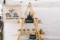 The ladder adds geometric uniqueness to the display while still achieving its functional purposes. Market Stall Display, Market Displays, Market Stalls, Retail Displays, Merchandising Displays, Craft Show Booths, Craft Booth Displays, Craft Show Ideas, Window Displays