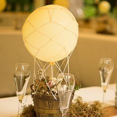 Hot Air Balloon Centerpieces // Arlene Chambers Photography // Flora D' Amore by Stadium Flowers // http://www.theknot.com/weddings/album/a-playful-outdoor-wedding-in-snohomish-wa-140137