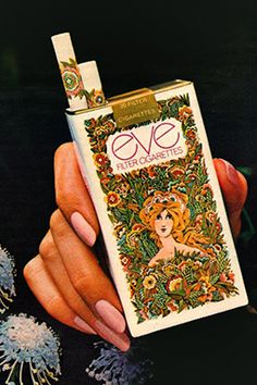 Early 1970s eve Filter Cigarettes in a psychedelic, trippy, MOD, flower power kind of package. Introduced in 1971 to thwart the competition of Virginia Slims. The filter and box of early 70s generation Eves were decorated with flowers to look feminine and fashionable, specifically signifying that this was a lady's cigarette, as well as to catch the eye of consumers.