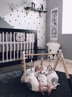 I don't see black and white baby rooms often but I love this one! What do you think? Do you like it or would you add more color?