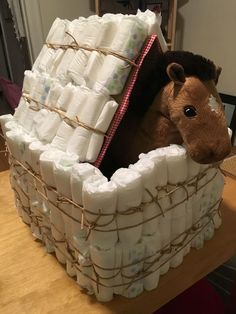 Horse in a barn diaper cake - diaper cakes are boring... but a diaper barn for a cowboy-themed baby shower? you bet! fun fact: I used only string and gravity to pull off this crazy construction of cardboard and diapers.